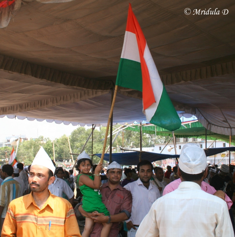 A Small Girl with the National Flag at Ramlila Maidan