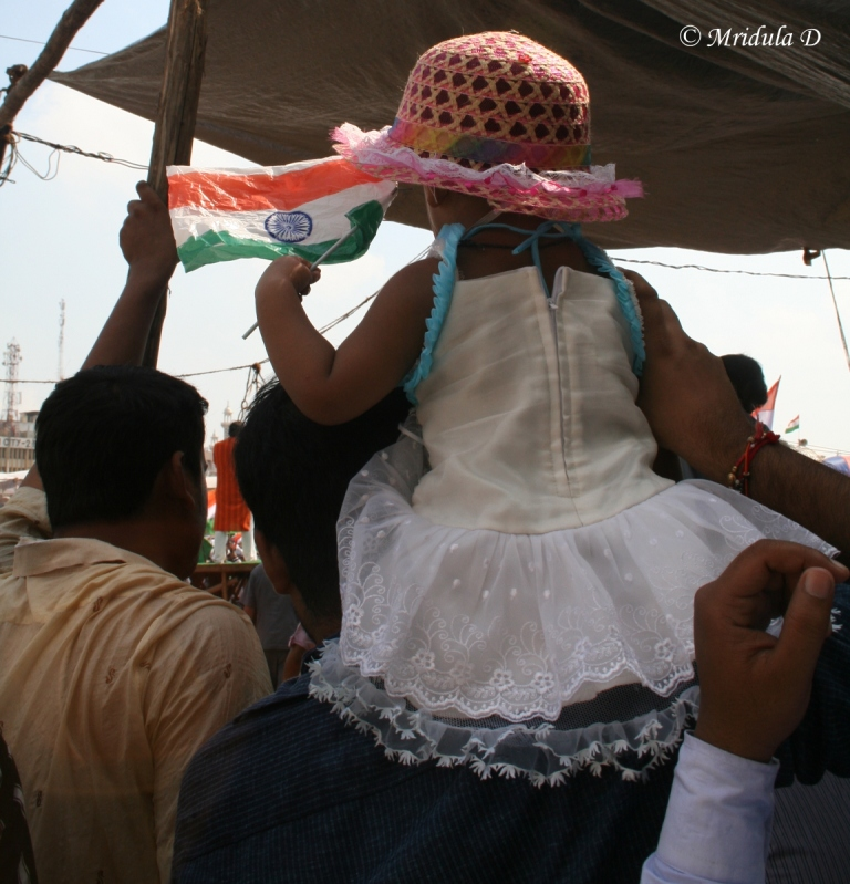 A Little Girl on Her Father's Shoulders at Ramlila Maidan