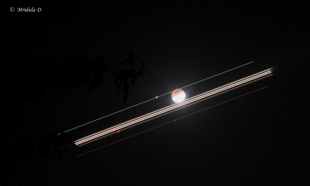 A Flight Goes Across Lunar Eclipse, December 10, 2011
