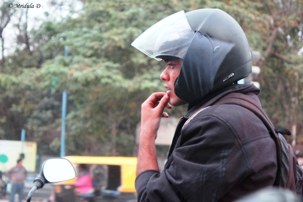 A Motorcyclist Lost in Thought at a Traffic Signal