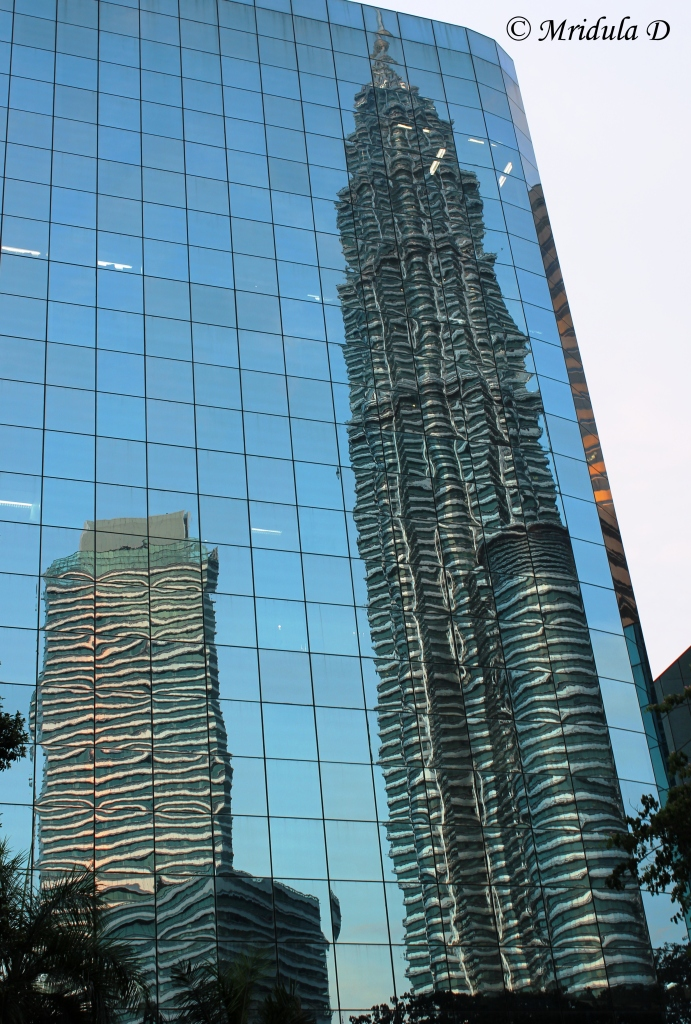 One of the Petronas Twin Towers Reflected in Another Building, Kuala Lumpur, Malaysia