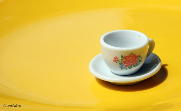 Toy Tea Cup on Yellow Background