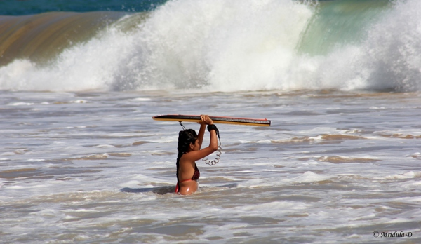 A Woman with a Surf Board at Mirissa Beach, Sri Lanka