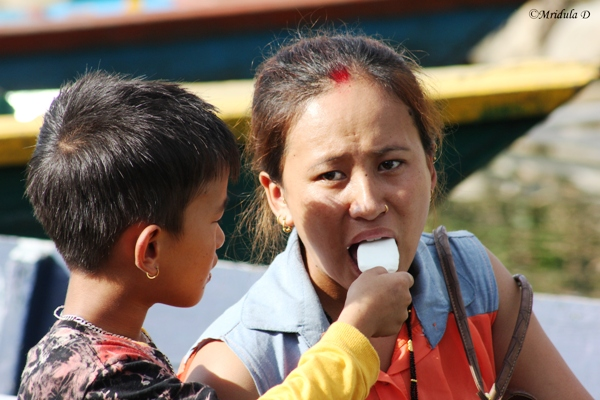 A Boy Sharing Icecream with his Mummy