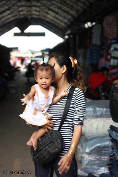 A Girl with Her Mother around Their Shop