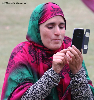 A woman using her cell phone in Srinagar, India