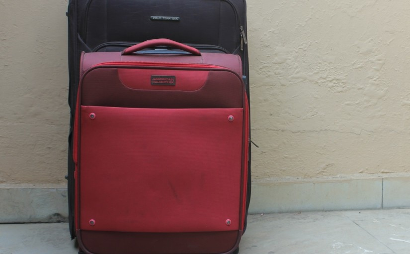 a red color suitcase