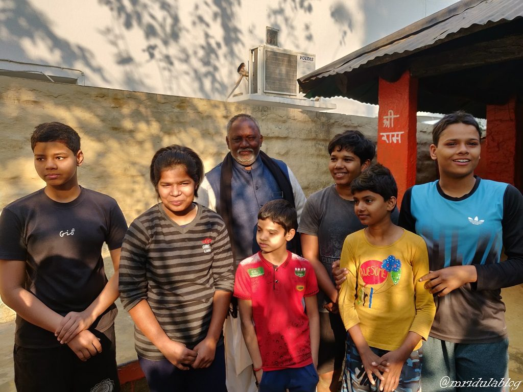 The young wrestlers of the Tulsidas Akhada with their Guru